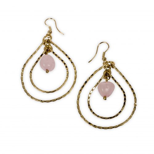 A pink stone enveloped by concentric teardrops. Rings are made of brass and stone is natural. Sustainable fashion.
